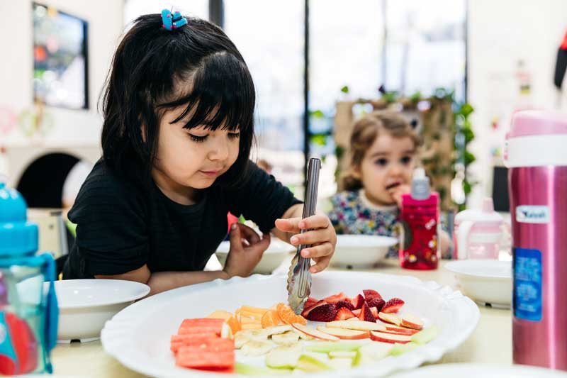 hild tastes different fruits discovering why eating healthy is important.