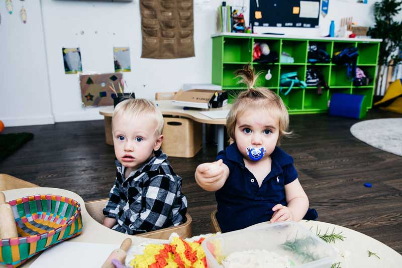Boy and girl engaging in interests while setting children into care