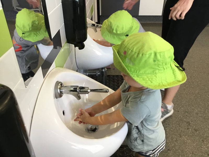 Children learn to wash hands to hand washing rhymes.