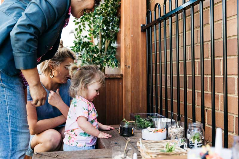 Family engage in an easy Earth Day tip activity like growing succulents.