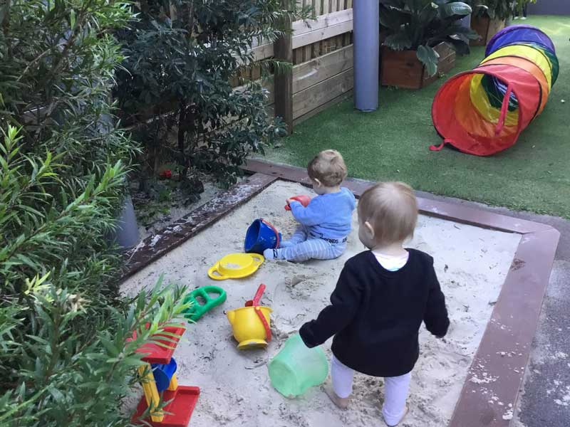 Reluctance to share while playing outside can be an early sign of sibling rivalry.