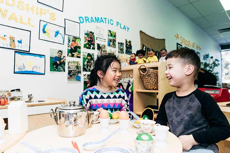 Diversity and inclusion activities include children roleplaying with assorted multicultural kitchenware.