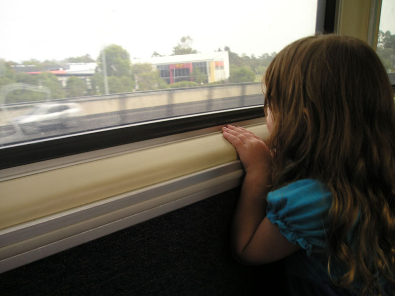 Looking out the train window - travelling with children on a train.