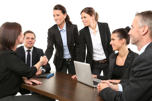 picture of corporate team shaking hands