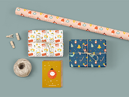 Wunderschönes Geschenkpapier und Schleifenband für Weihnachten