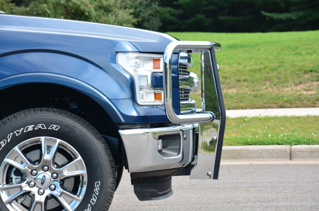 Blue Ford F150 with chrome grille guard by LUVERNE