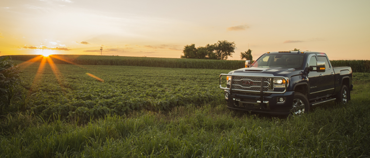 GMC Sierra 3500HD with a LUVERNE grille guard on the farm at sunset