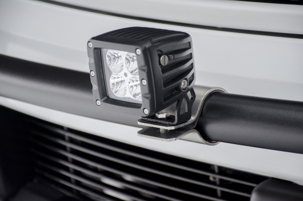 LED work light with 2 inch tabs on LUVERNE grille guard