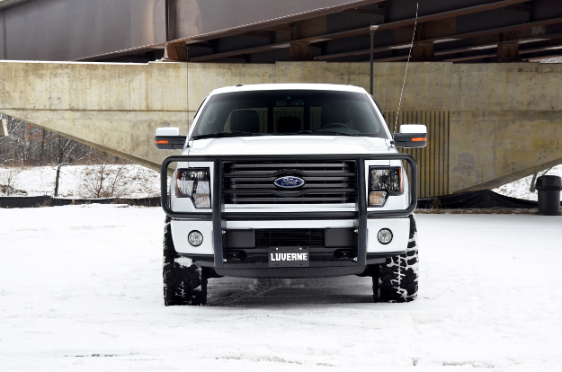 White Ford F150 in snow with black grille guard from LUVERNE