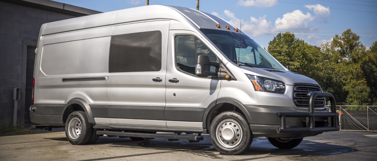 Grey 2017 Ford Transit with LUVERNE Grip Step™ van running boards