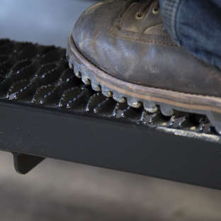 Work boot on LUVERNE Grip Step van running boards