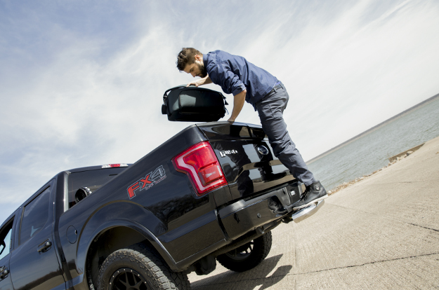 Black Ford F150 with LUVERNE MegaStep® receiver hitch step - worker