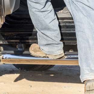 LUVERNE MegaStep® running boards on work truck - worker boots