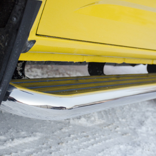 LUVERNE MegaStep® running boards on yellow truck