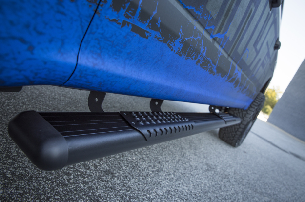 Black O-Mega II™ truck side steps on a custom truck