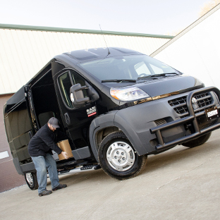 Black Ram ProMaster 2500 work van with LUVERNE O-Mega II™ steps and Tuff Guard® bumper guard