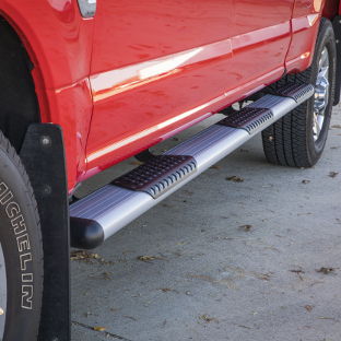 Red truck with silver O-Mega II™ side steps from LUVERNE