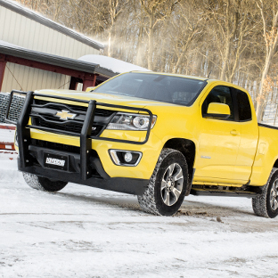 Yellow Chevrolet Colorado with LUVERNE brush guard and O-Mega II™ side steps