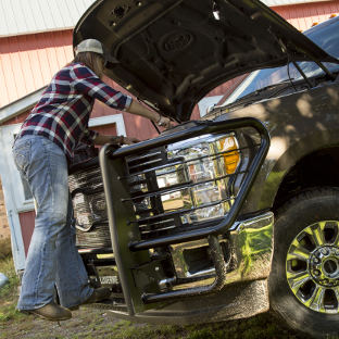 Engine work on Ford F350 with LUVERNE Prowler Max™ grille guard step