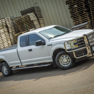 White 2015 Ford F150 with Regal 7™ side steps and grille guard from LUVERNE