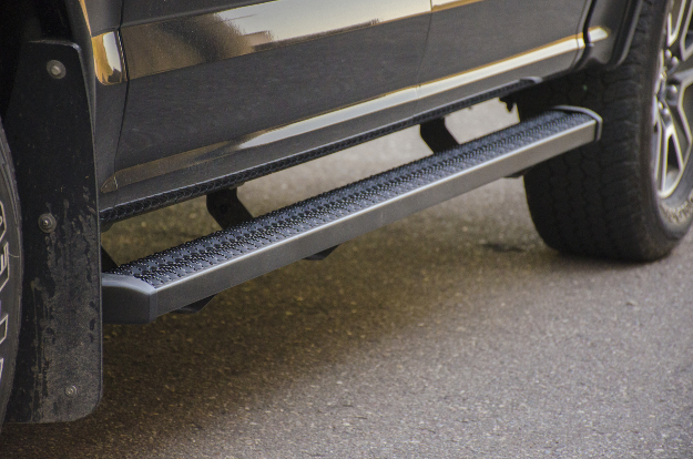 LUVERNE SlimGrip™ running boards on black truck