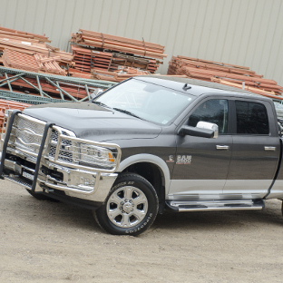 Grey Ram 3500 work truck with LUVERNE Side Entry Steps and brush guard