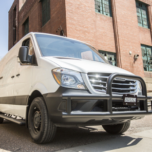 LUVERNE Tuff Guard® grille guard on white 2016 Freightliner Sprinter 2500 in industrial park