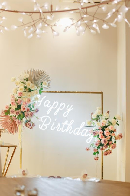 Gold Dress Rack, 'Happy Birthday' Neon Light and Floral Arrangements by Luxe Dream Event Hire and Floral Studio