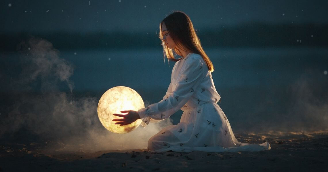 A woman holding a moon