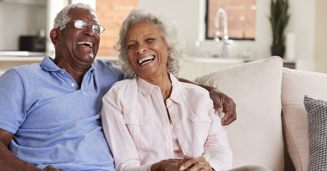 An older couple laughing together