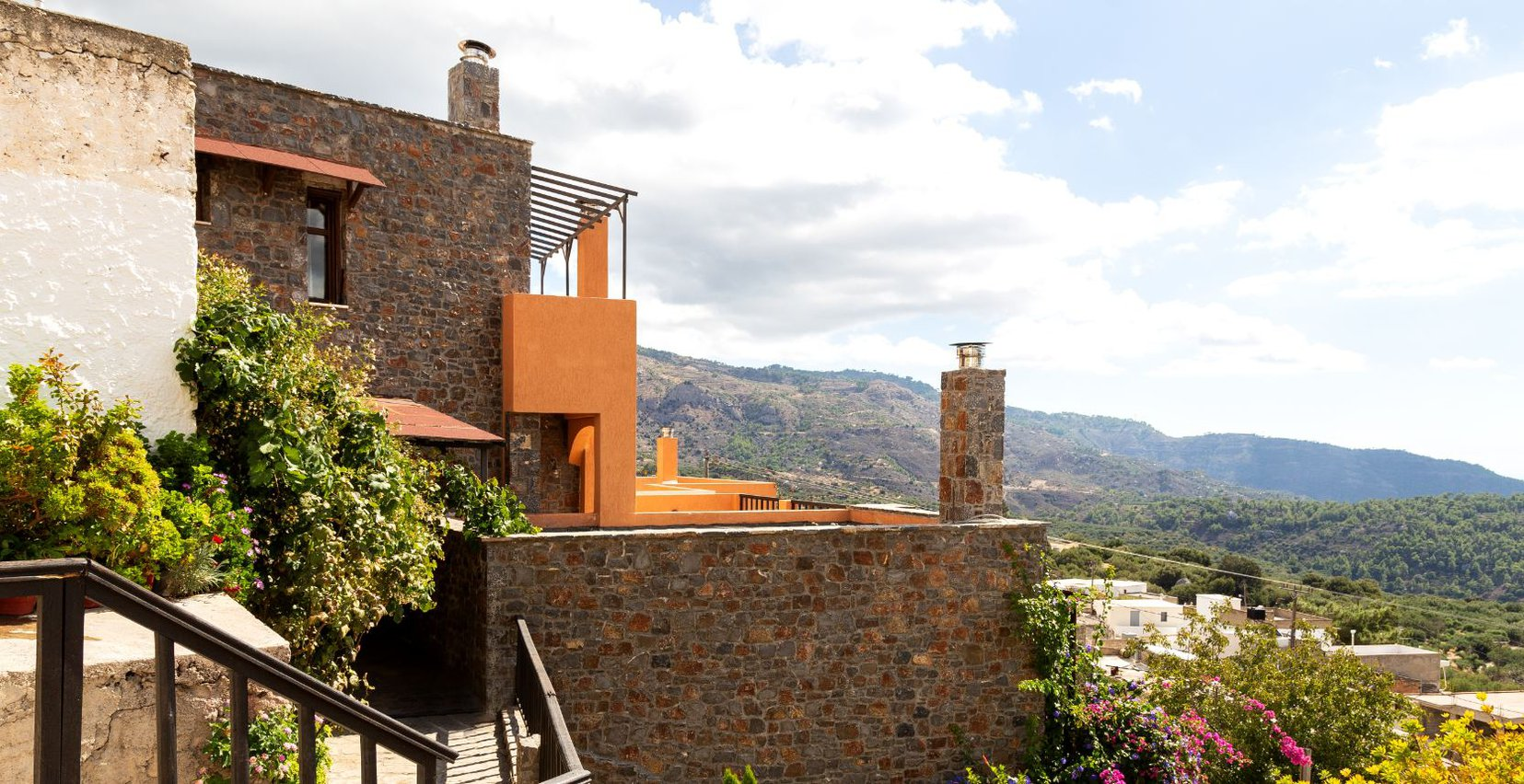 Mala Villa with the mountains in the background