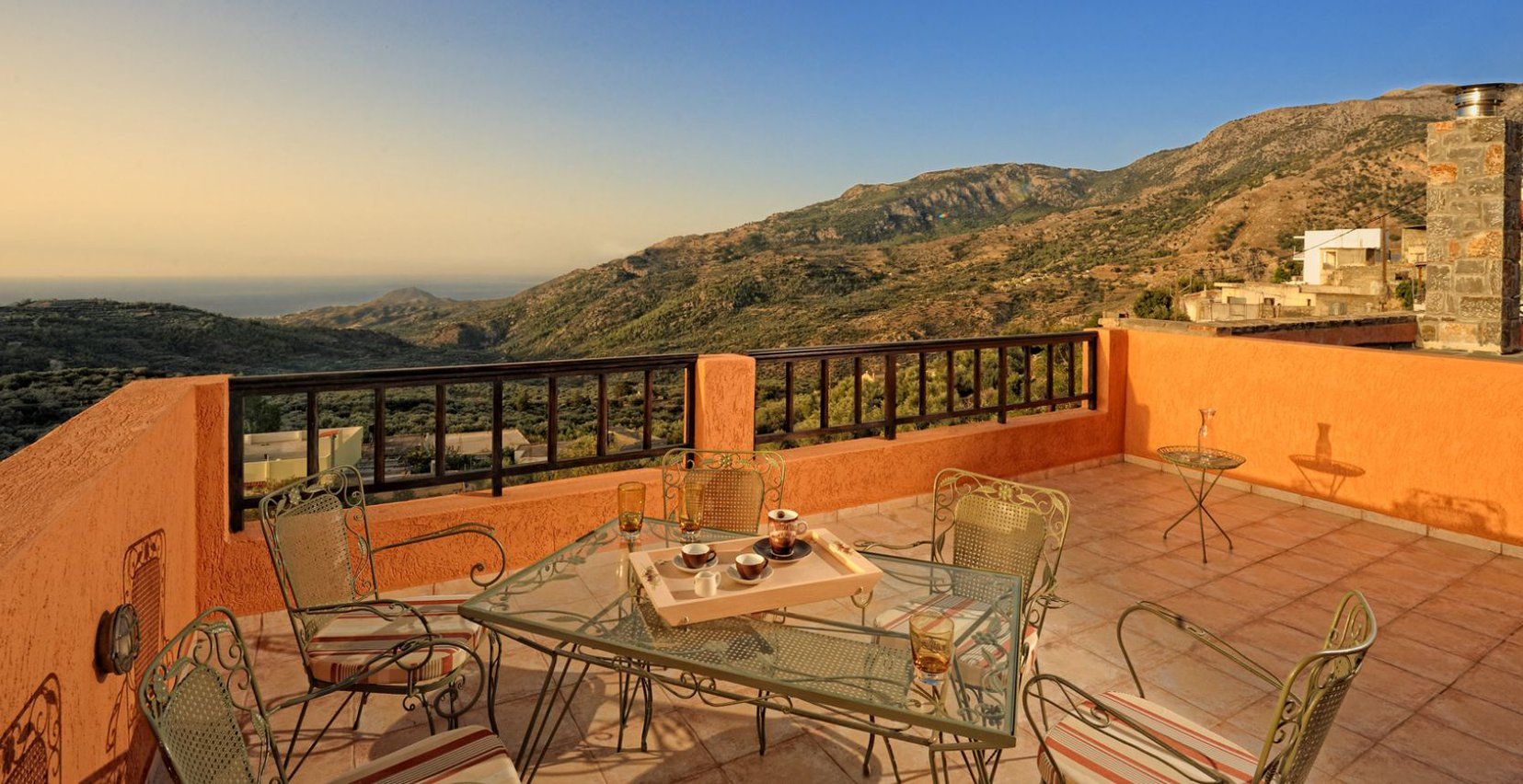 The view of the Malles mountains and the sea from the balcony of the Dittany Love Maisonette of Mala Villa