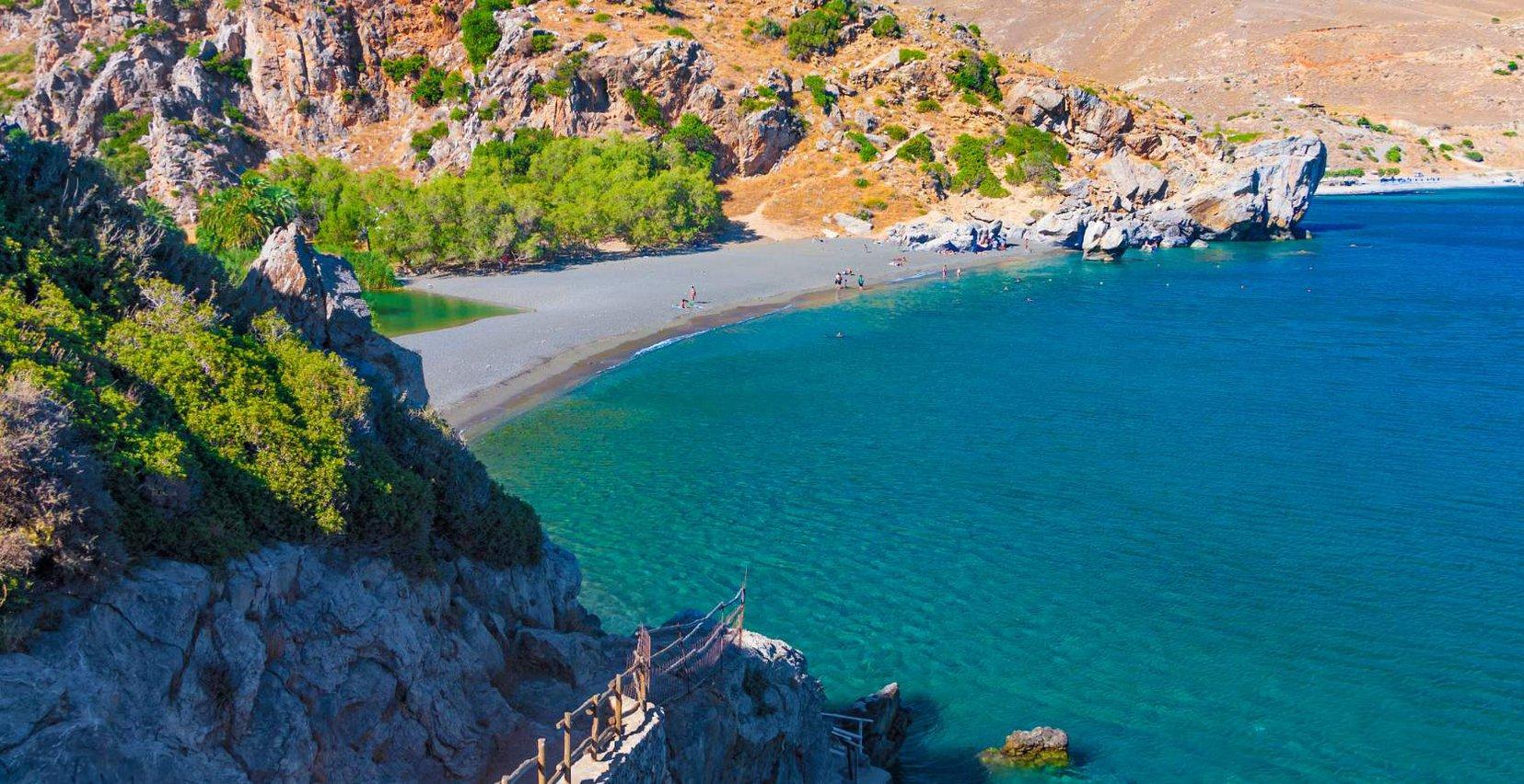 Beautiful beach near Mala Villa surrounded by mountains