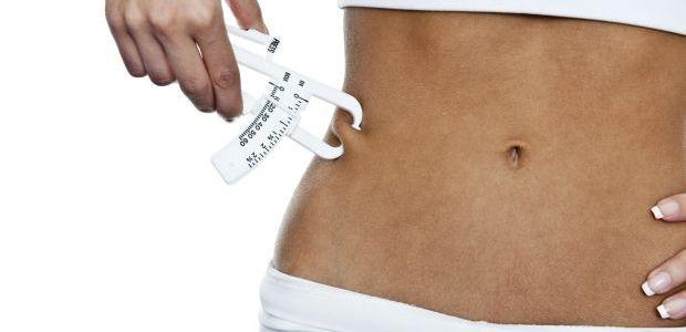Woman using fat calibration device