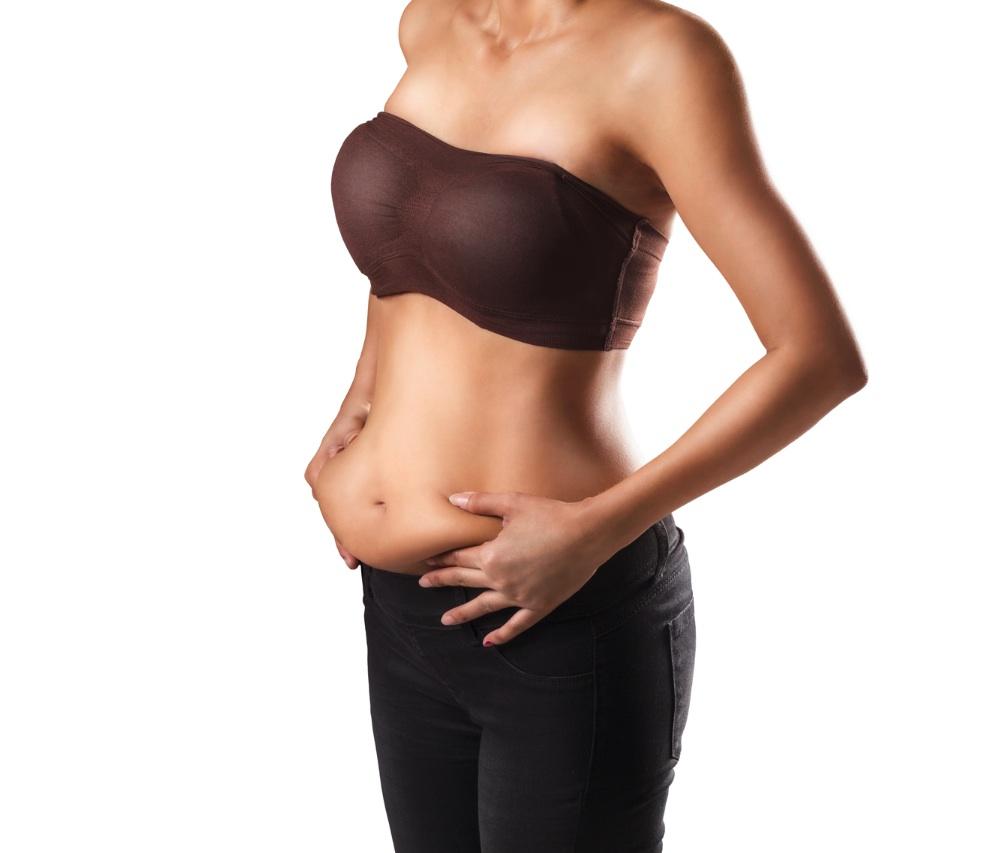 gasig i magen innan mens