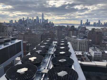New York skyline showing a row of drycoolers, part of the HVAC solutions installed for this client by Mantis Innovation