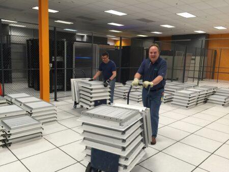 Data Center cooling efficiency blog header image two men working