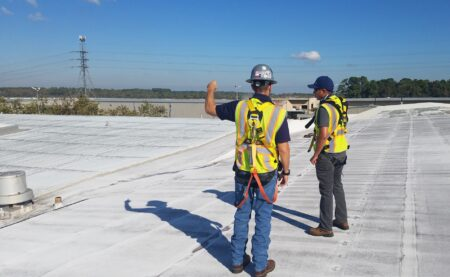 Multi year roof assessment header image men working on roof
