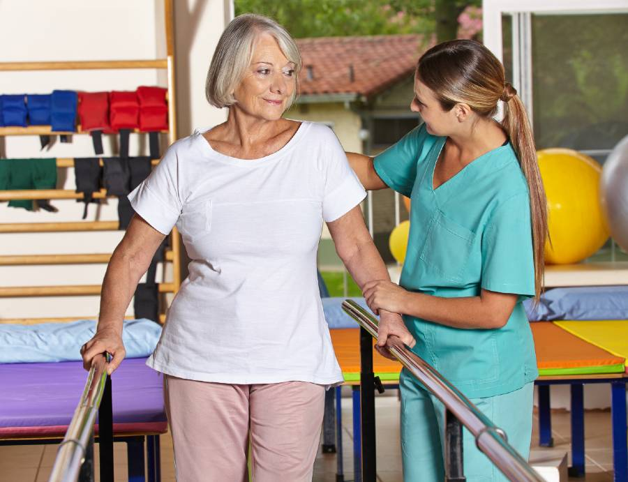 Senior woman working with a physical therapist