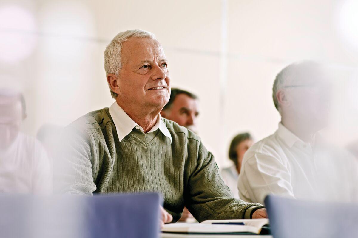 Senior man taking an in person class