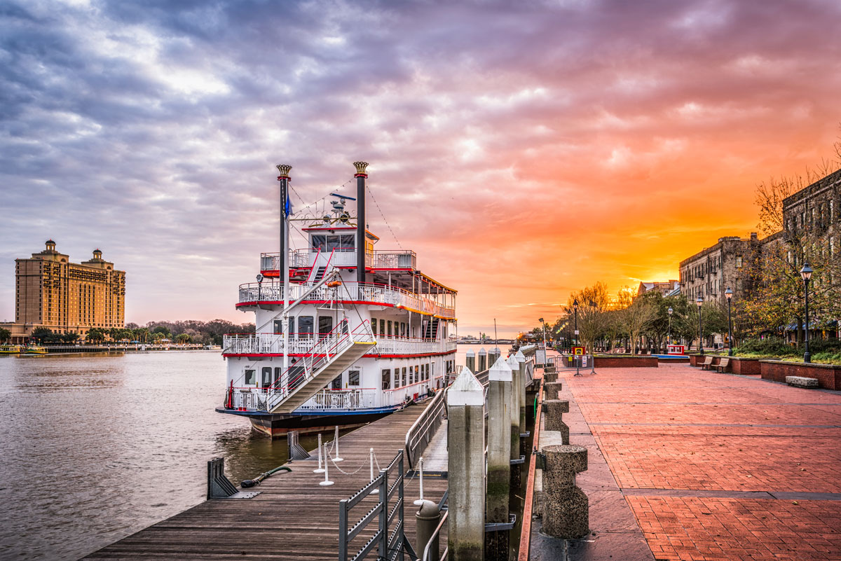 A riverboat docked on the river in Savannah