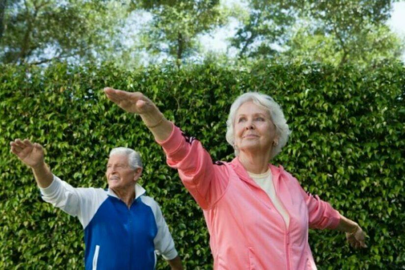 Two seniors practice tai chi for senior mobility