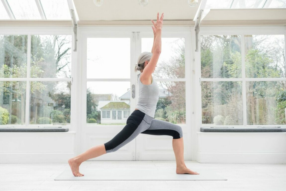 A senior does yoga to receive the mental and physical benefits.