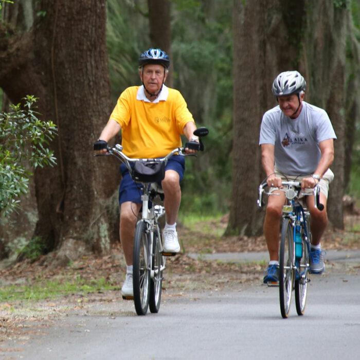 Senior men biking together