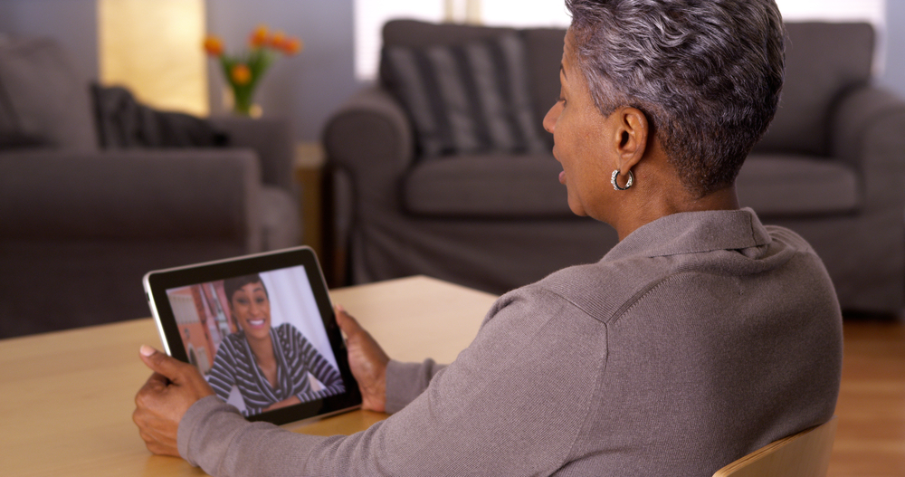 Senior woman talks to her daughter through video chat