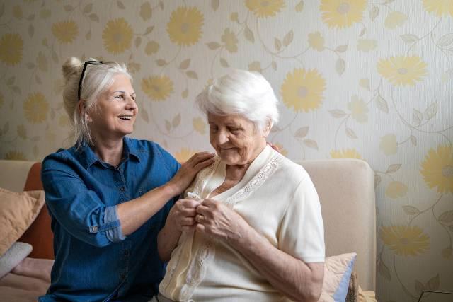 Two senior women embracing