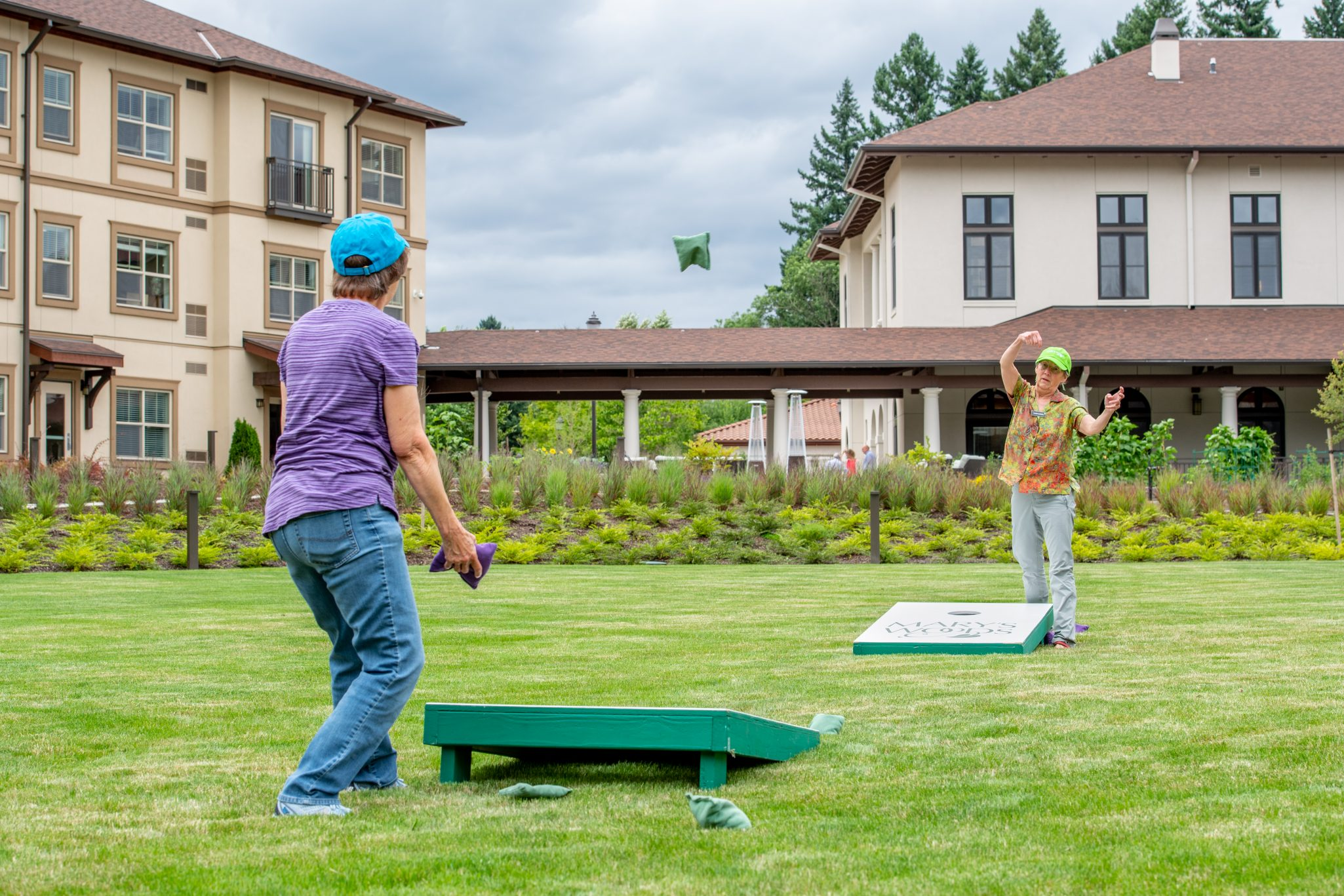 Two people playing lawn games