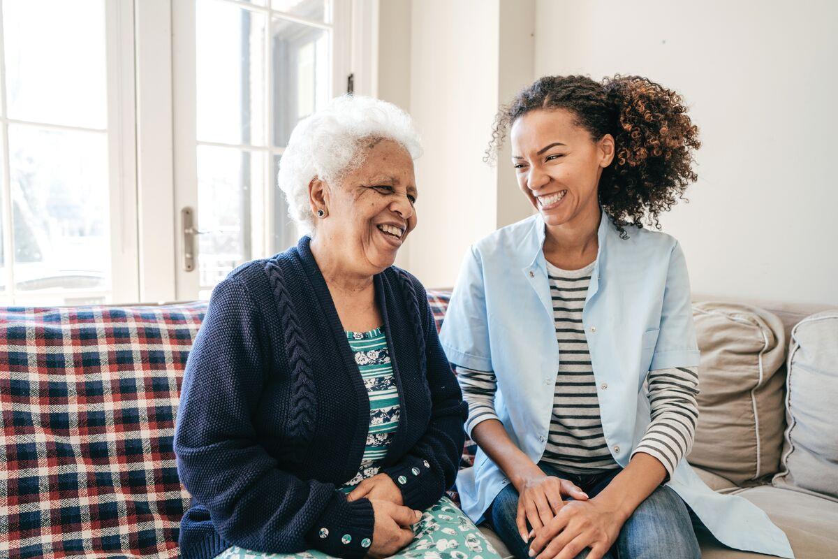 Senior woman sitting with a nurse