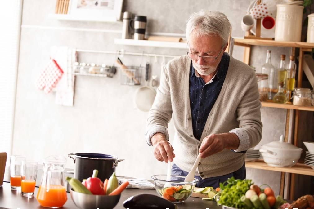 Senior man making a salad