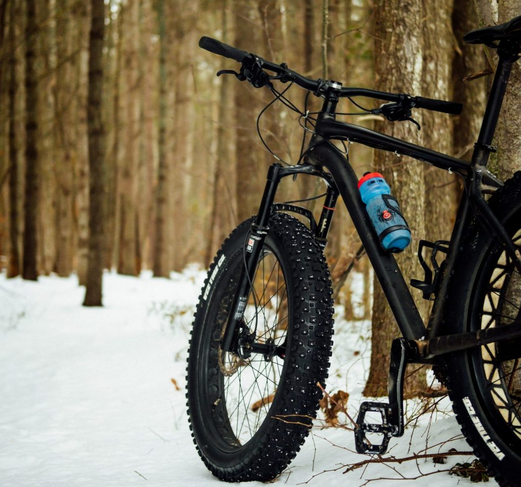 a fat bike sitting on the snow
